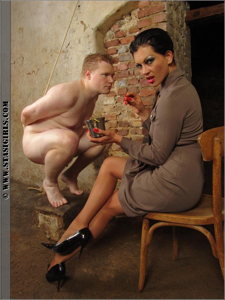 image Hot mistress tortures slave balls cbt
