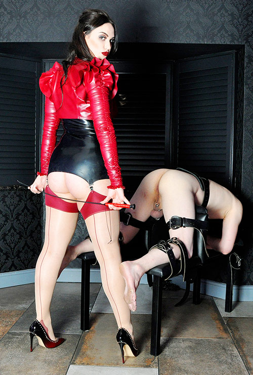 brutal dominatrix with a cane