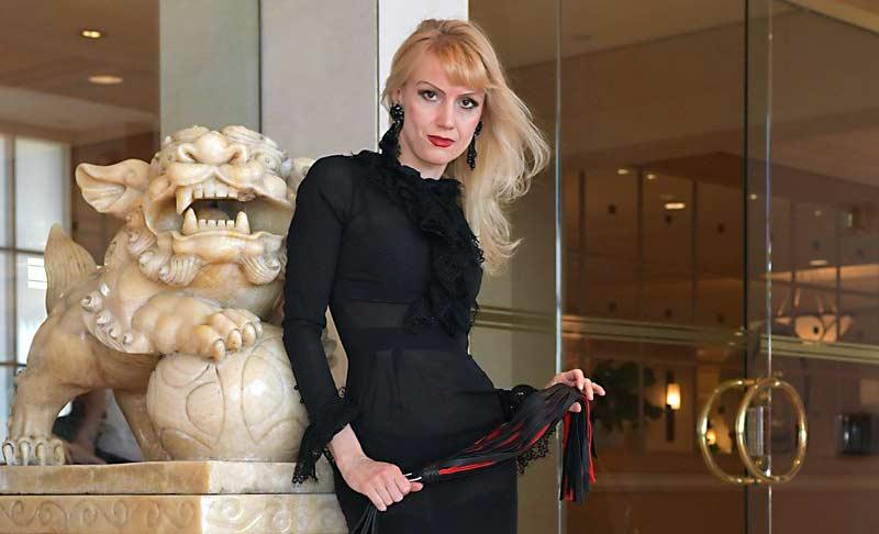 Karin Von Kroft with a whip