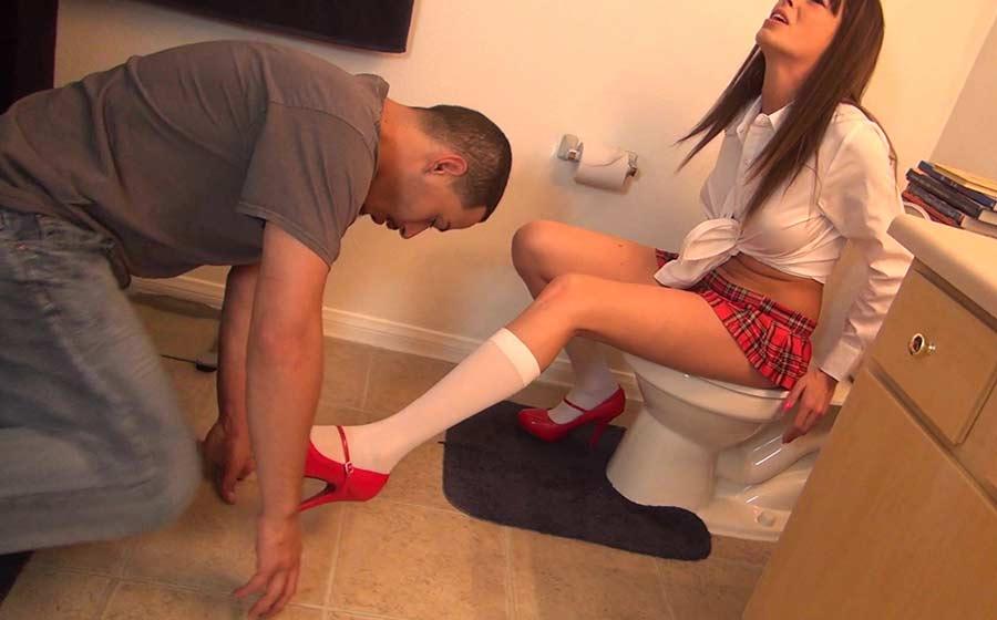 Mistress sitting on toilet