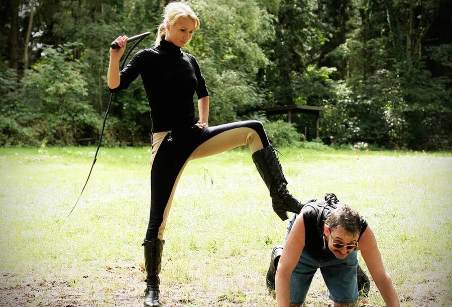 dominatrix whipping human pony