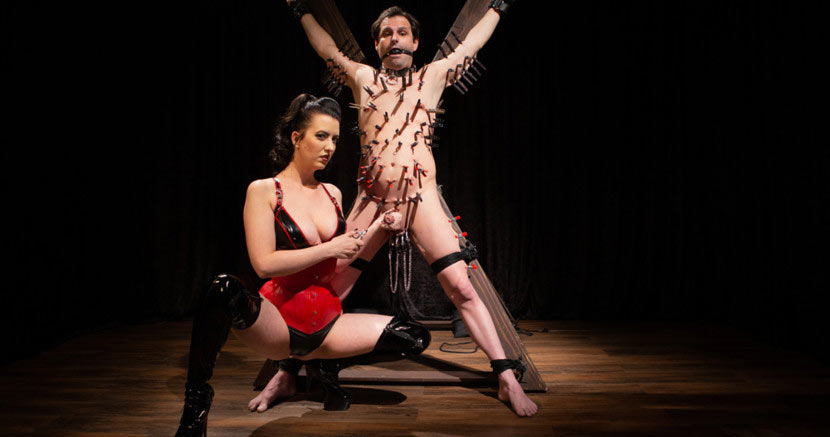 dominatrix torture slave tied in dungeon