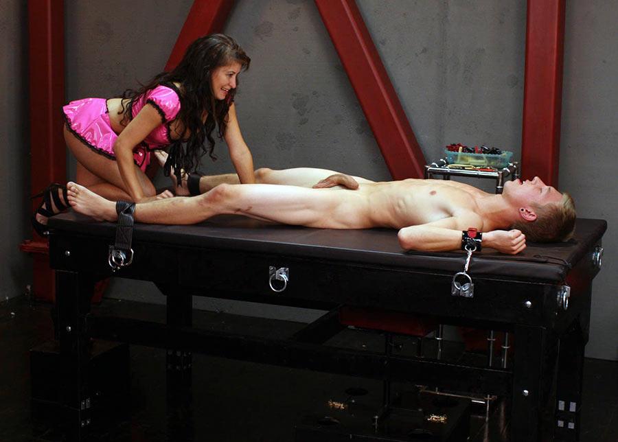 sexy dominatrix approaching femdom slave